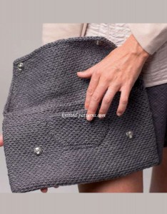 Knitted clutch with patch pocket